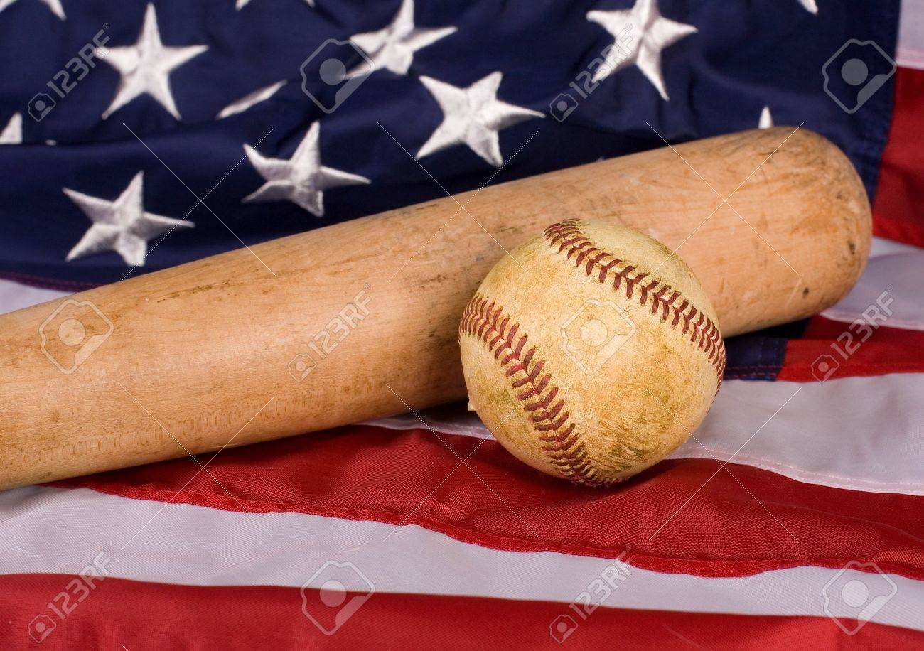 Old baseball and and bat with American flag. Focus is on ball. Stock Photo 3b25094fdfb