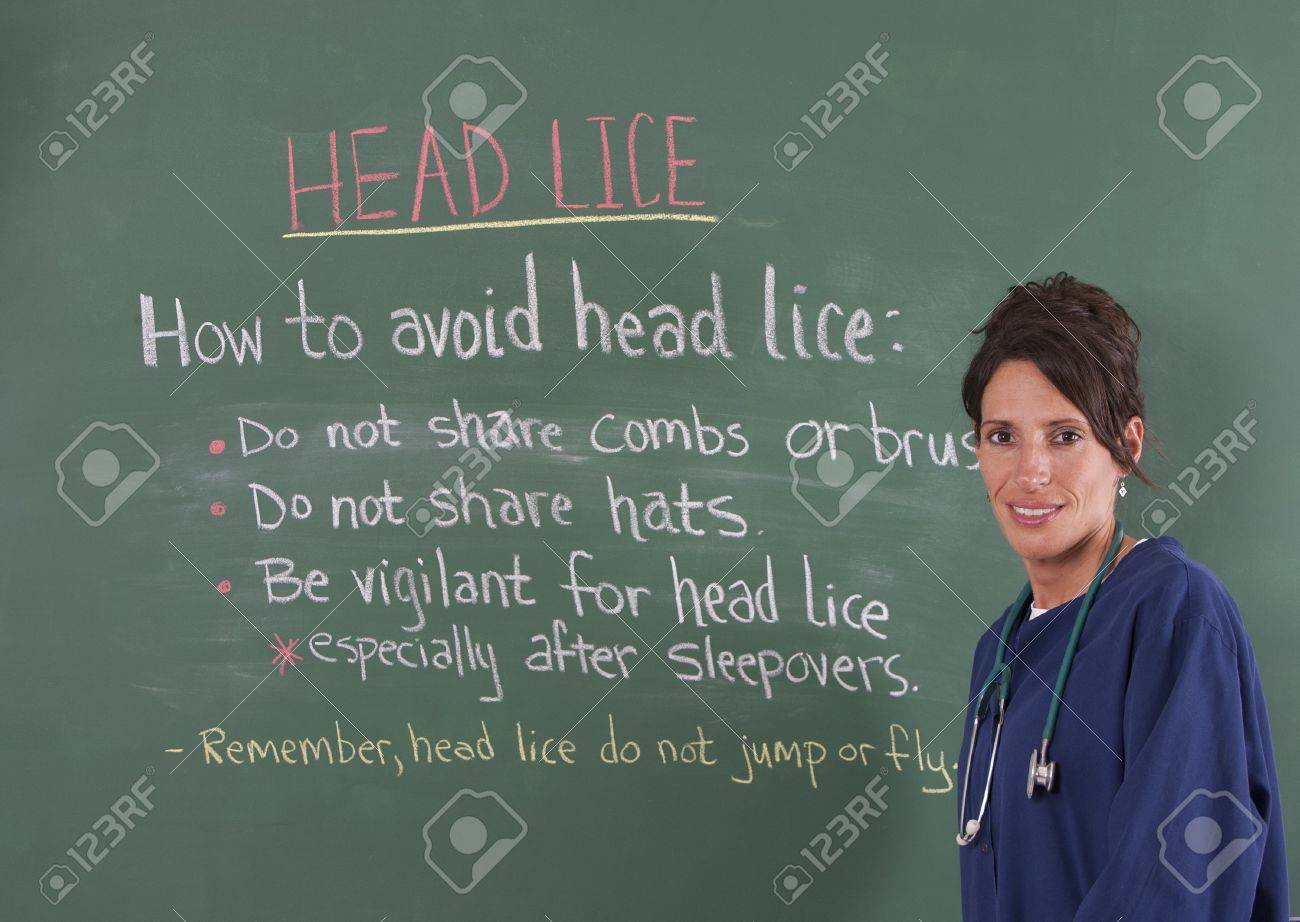 school nurse teaching about head lice on chalkboard of classroom