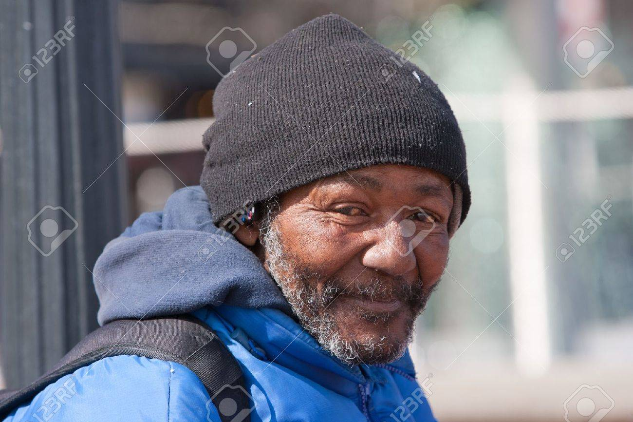 Happy homeless african american man outdoors during the day. Stock Photo - 18693279