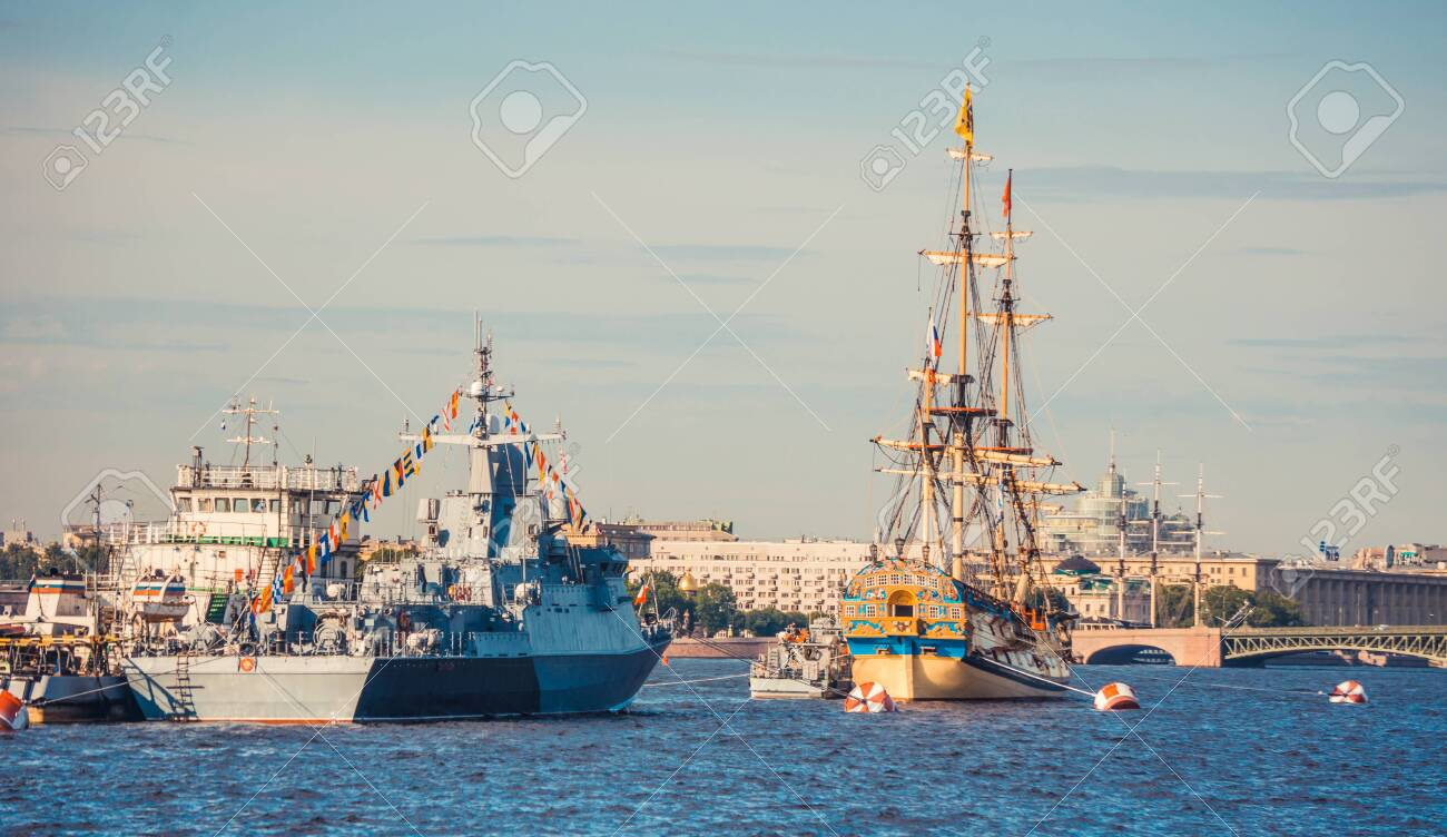 ST.PETERSBURG, RUSSIA - JULY 23, 2019 - Russian warship and sailboat at celebration of the Navy Day - 141904305