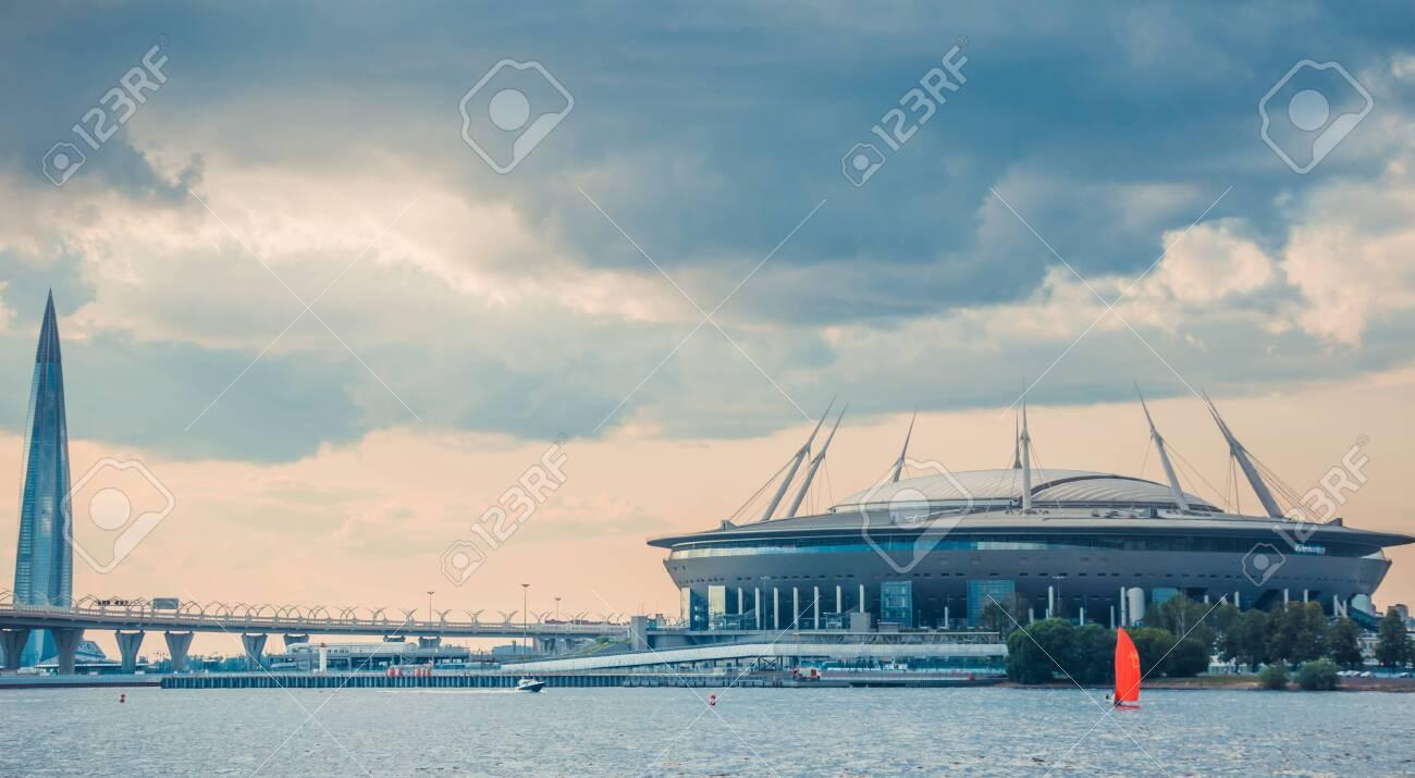 ST.PETERSBURG, RUSSIA - JULY 23, 2019 - Gazprom Arena stadium and Lakhta Center skyscraper shot from Neva river. - 141904303