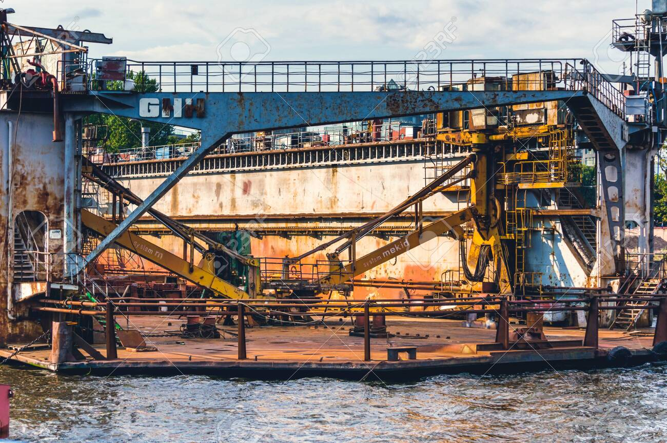 St.Petersburg, Russia - July 23, 2019 - Heavy machinery on floating barge on Neva river - 141904636