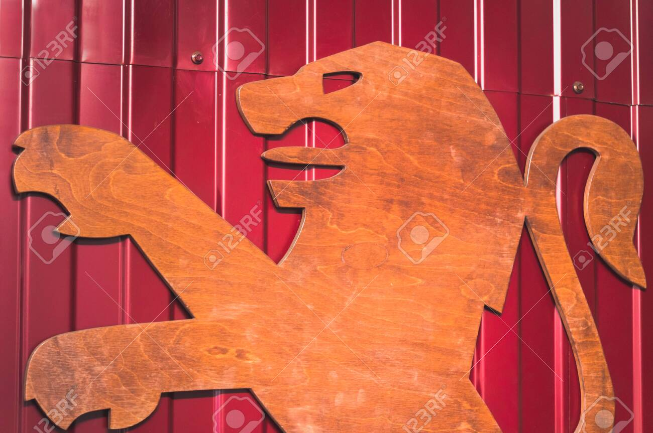 ST.PETERSBURG, RUSSIA - AUGUST 20, 2019 - Big wooden Peugeot logo on metal wall - 141906422