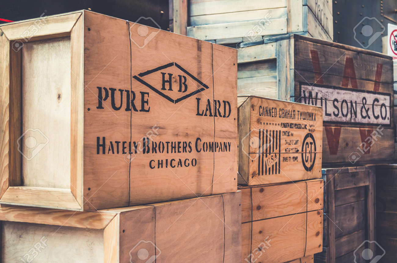 Installation of vintage branded wooden boxes with articles of merchandise - 143991314