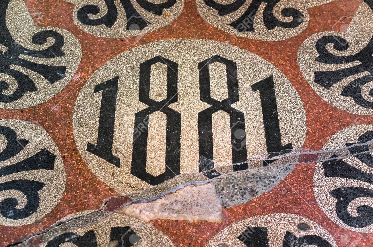 Inscription 1881 on shabby cracked floor in an old building in St. Petersbug, Russia - 144228010