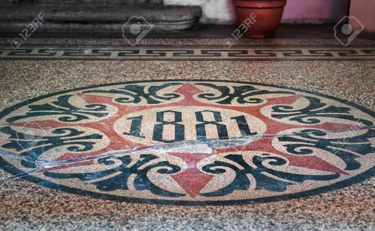 Inscription 1881 on shabby cracked floor in an old building in St. Petersbug, Russia - 144228025