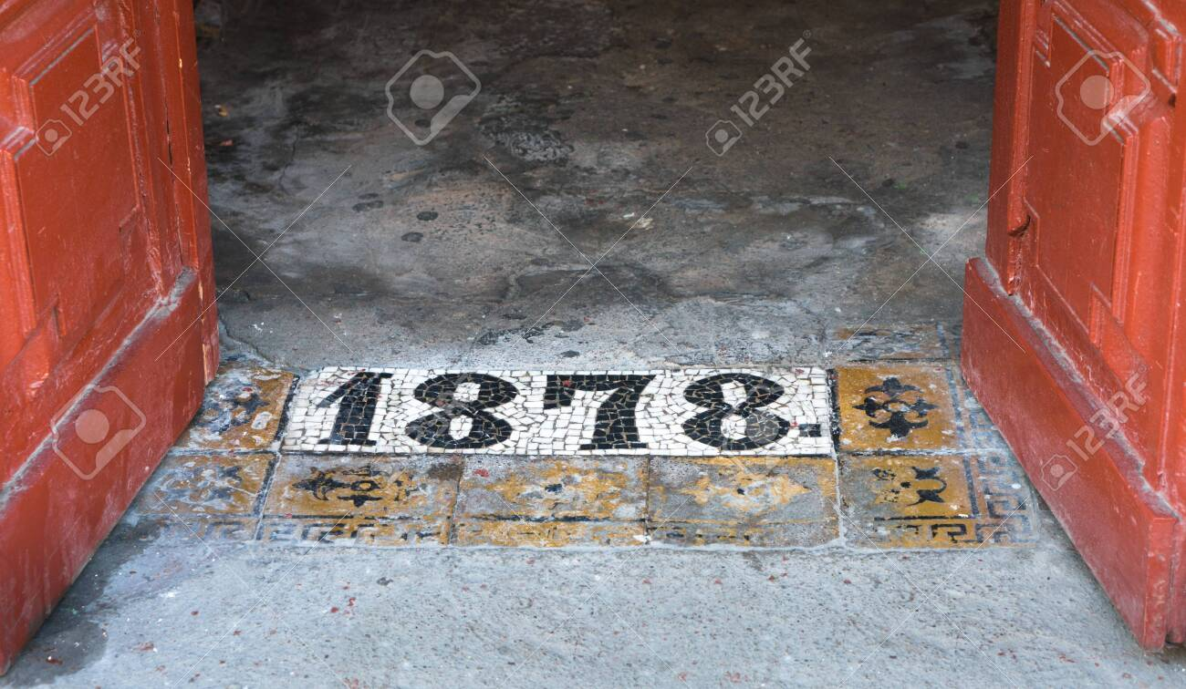 Inscription 1878 on shabby concrete floor by the entrance to an old building in St. Petersbug, Russia - 144237817