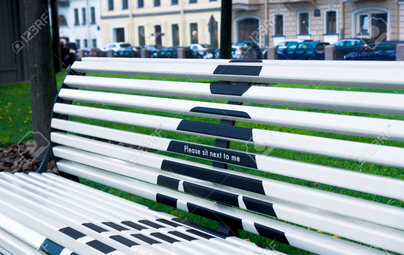 Concept of social distance of bench in public park - 164966351