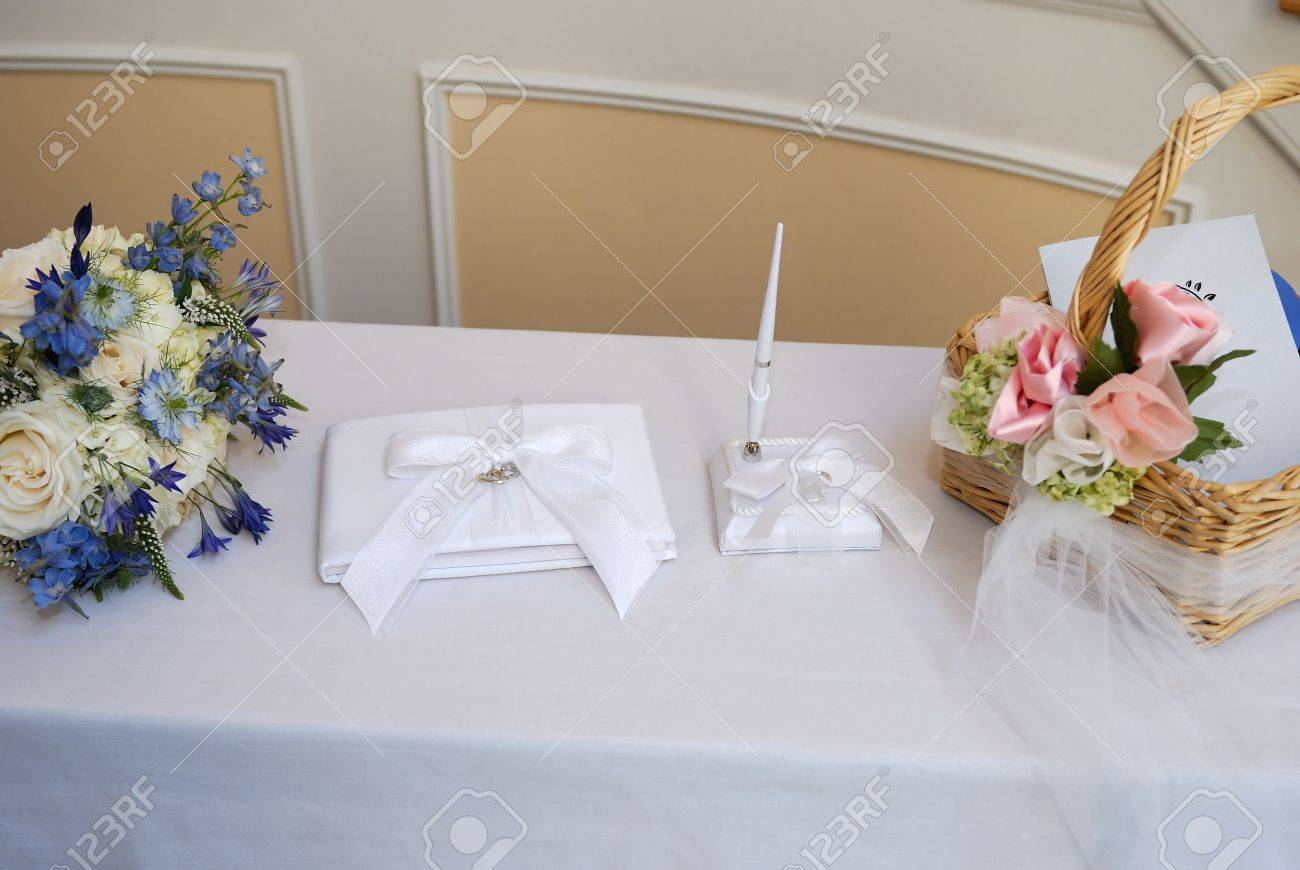 Wedding Reception Sign In Book On A White Linen Covered Table Stock ...