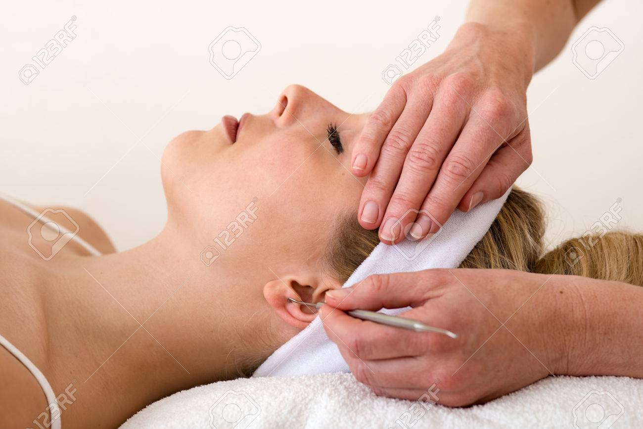 Chiropractor Applying Ear Acupuncture Techniques Homeopath Applying