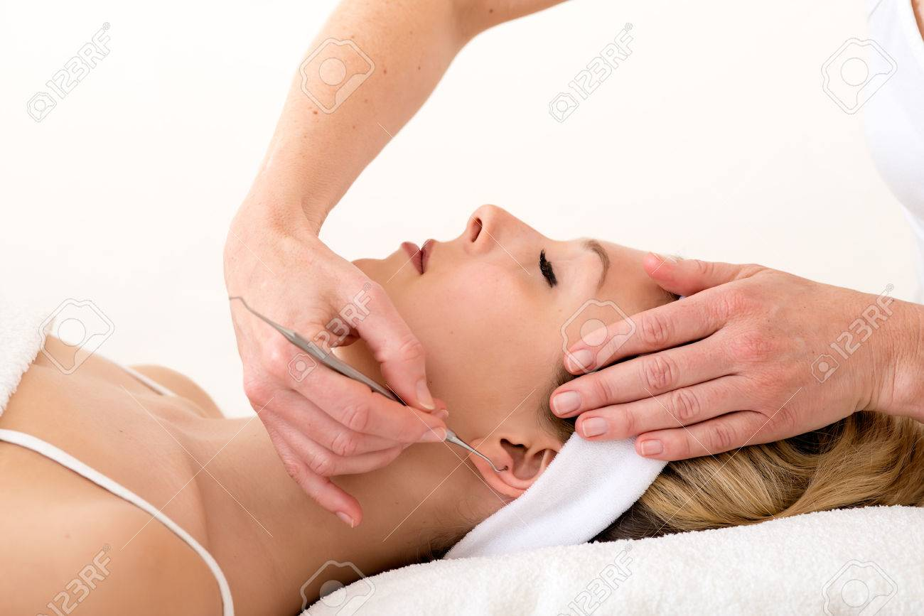 Homeopath Using Ear Acupuncture Techniques Alternative Practitioner