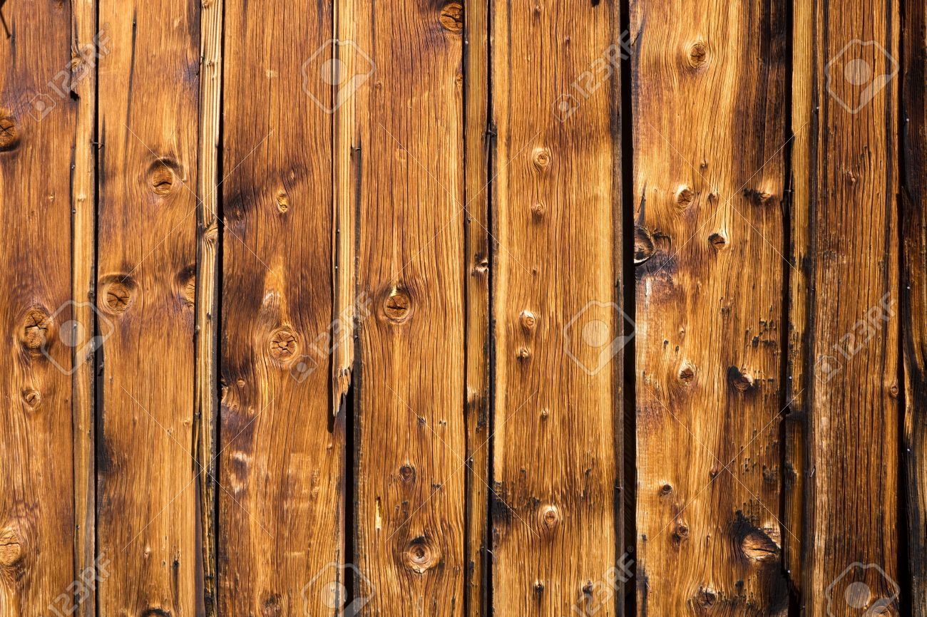 Vertical Brown Wooden Panels On The Exterior Wall Of A Rustic ...