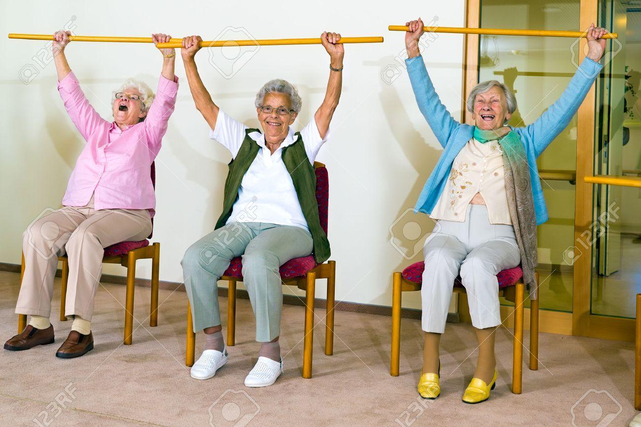 Three Happy Elderly Ladies Doing Exercises In A Seniors Gym Sitting ...