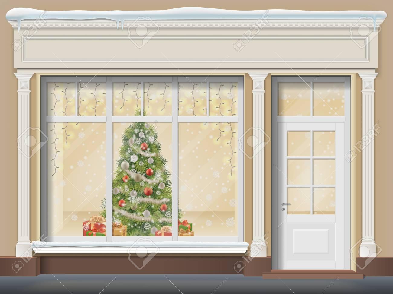 Decorazione Finestre Per Natale : Il negozio è con una porta e una grande finestra. vetrina di natale