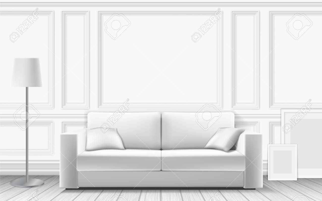 Modern sofa on background of white wall decorated with moulding..