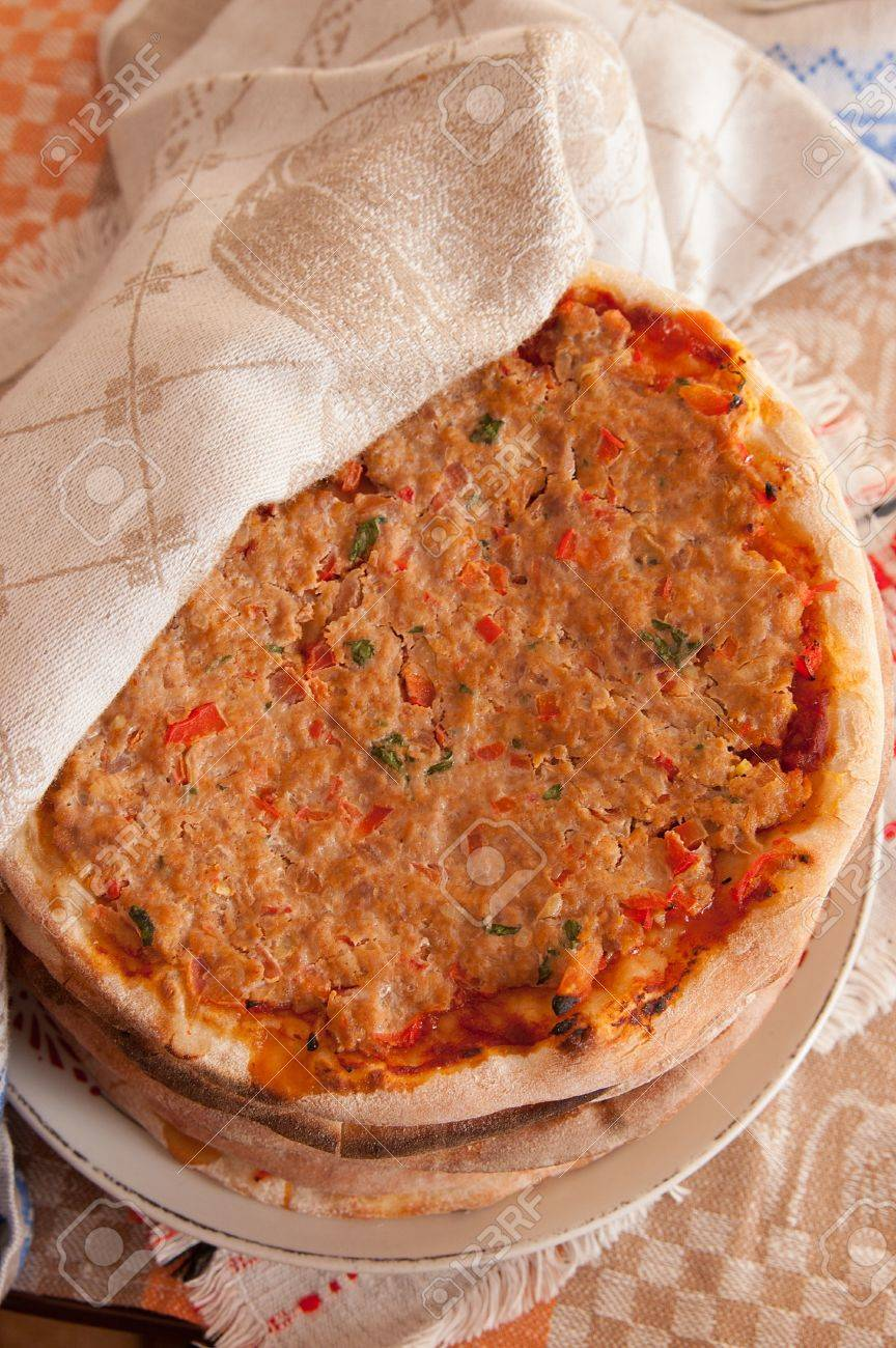pile of turkish lahmacun arab pizza on plate overhead stock photo 18348985