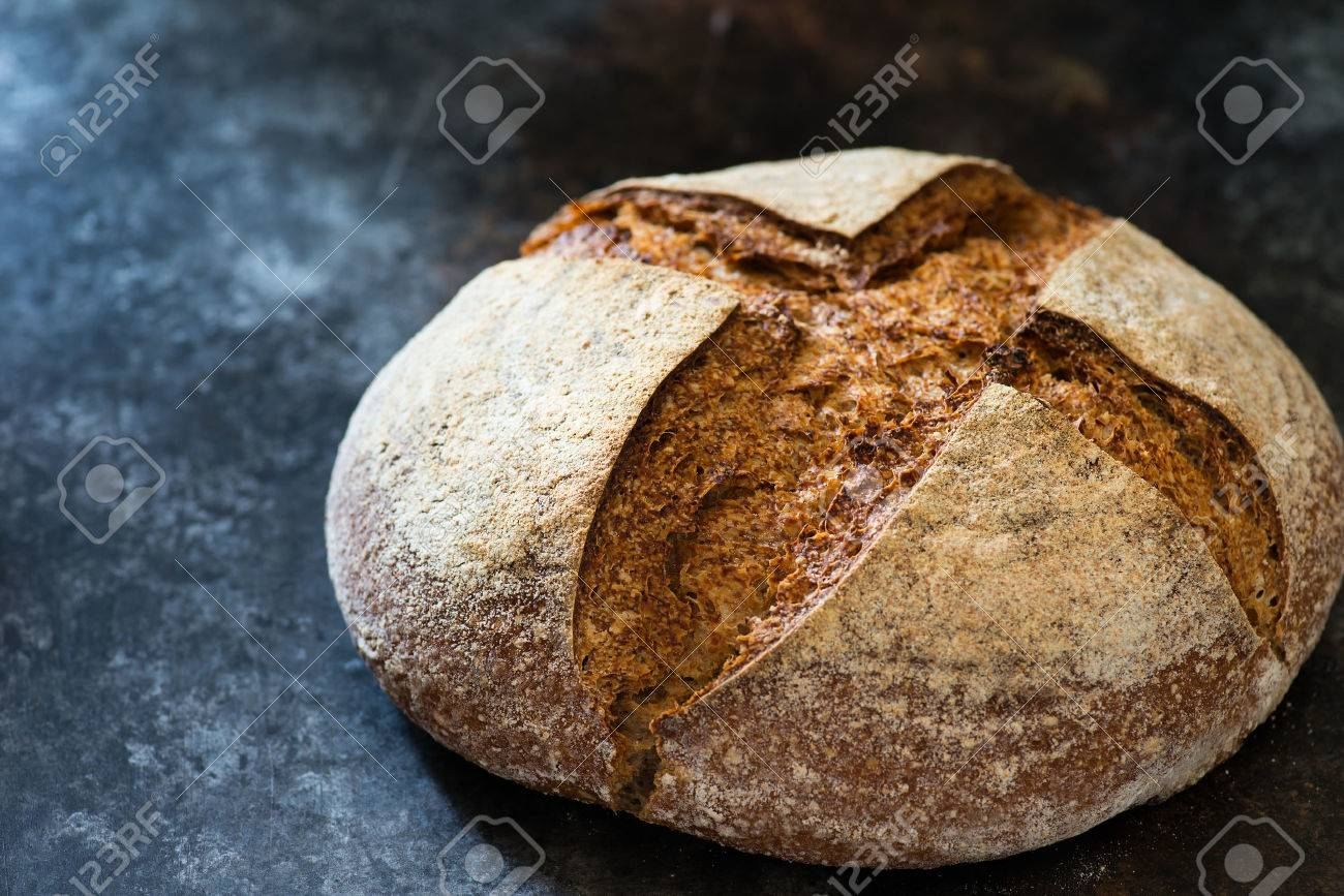 Homemade Rye Artisan Sourdough Bread Over Dark Background Selecrive Focus Closeup Stock Photo