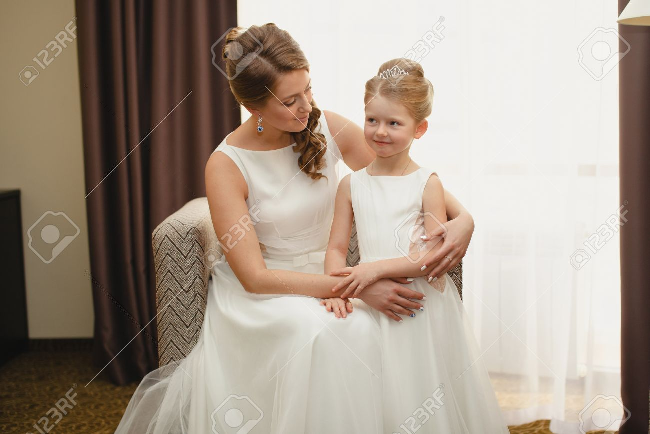 Mother And Daughter In The Same Wedding Dresses Having Fun Stock ...
