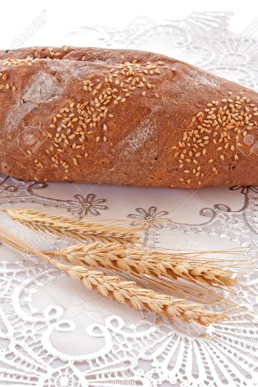 Fresh bread with ear of wheat Stock Photo - 6282517