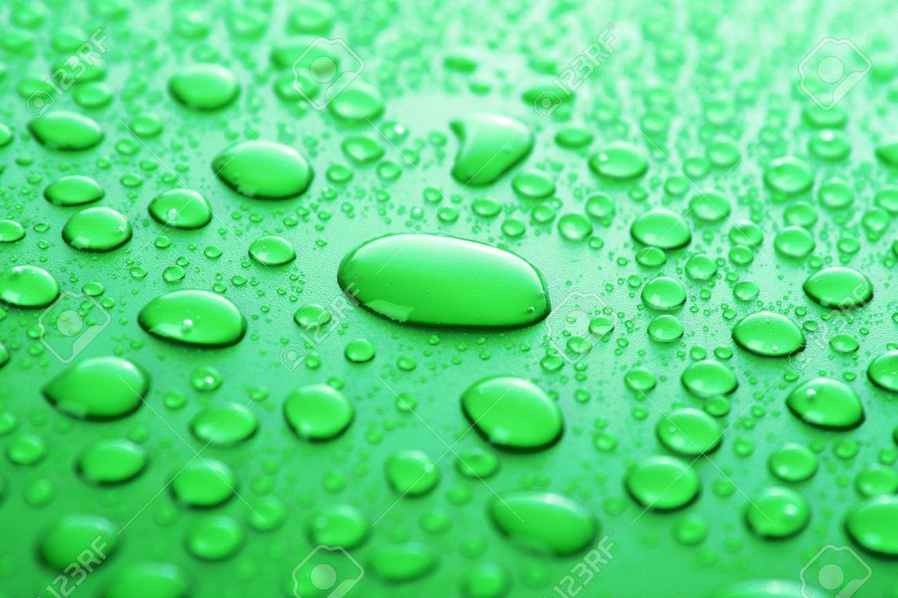 Green water drops background Stock Photo - 6479220