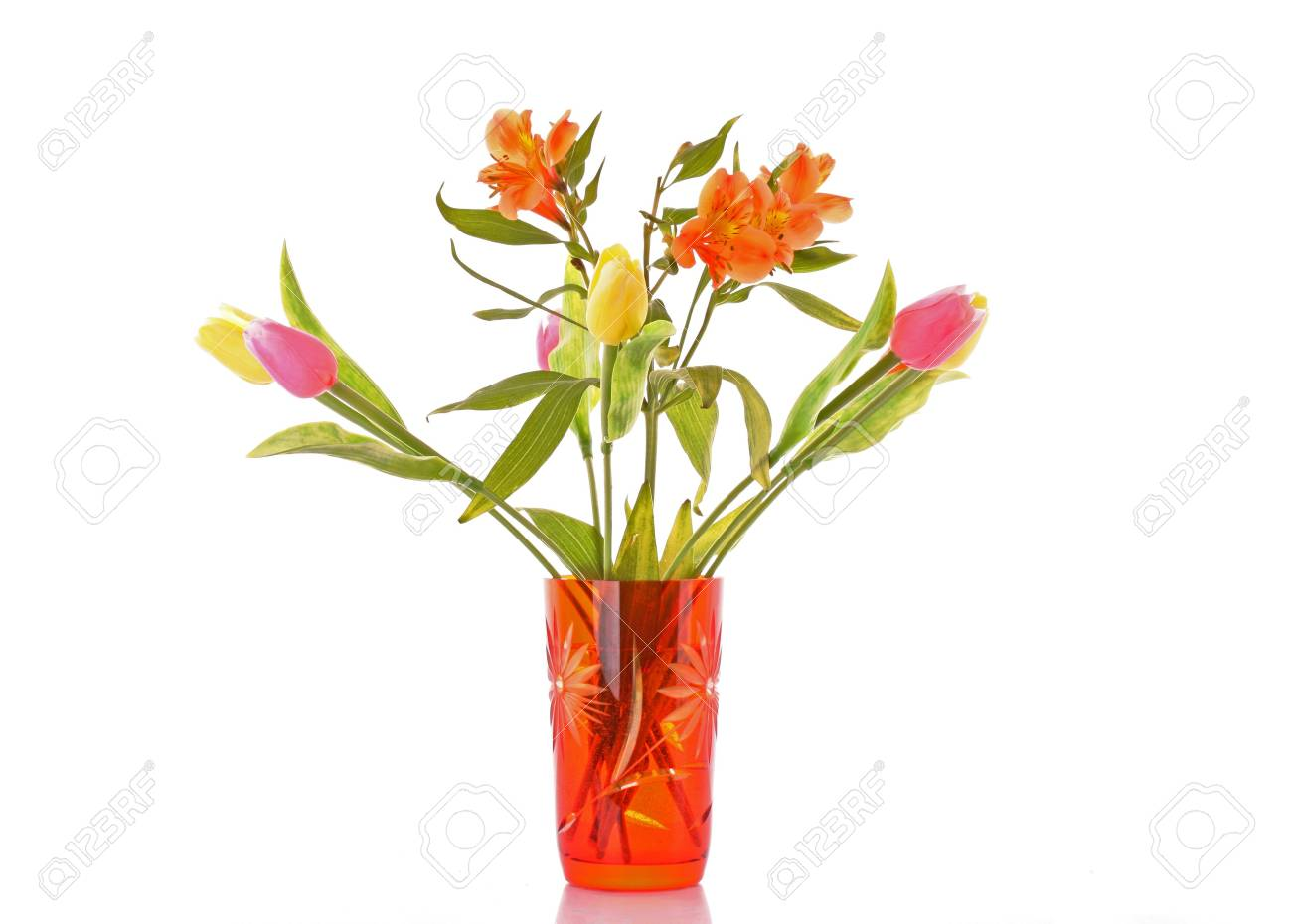 Flowers of lily and tulips in a vase on a white background Stock Photo - 6801656