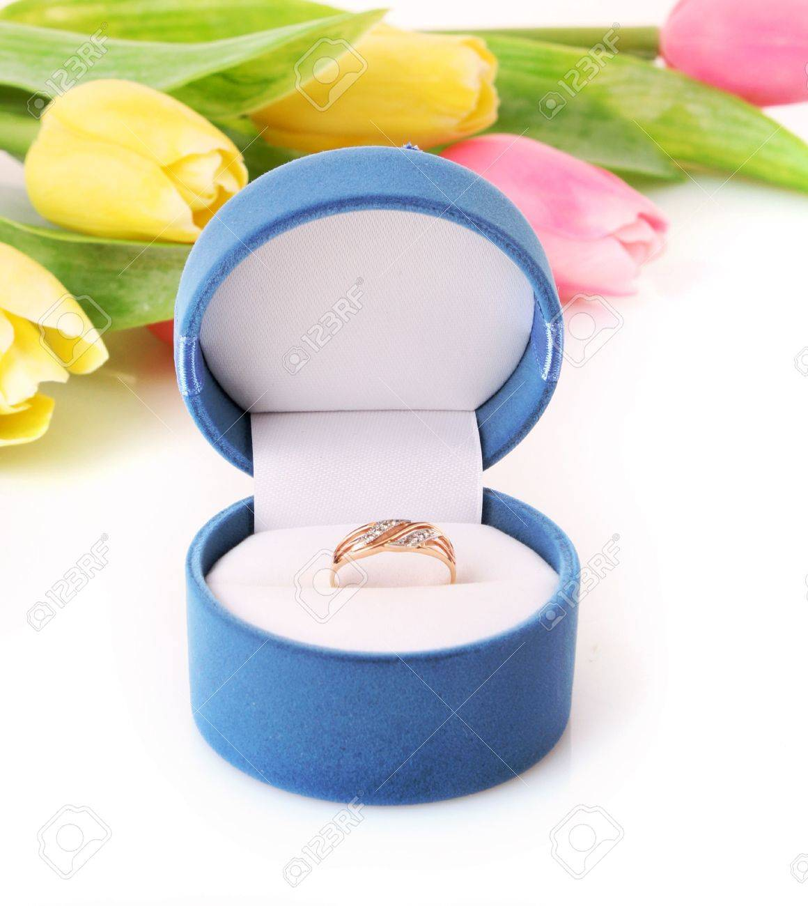 Gold  engagement ring in box on the flowers background Stock Photo - 6801783