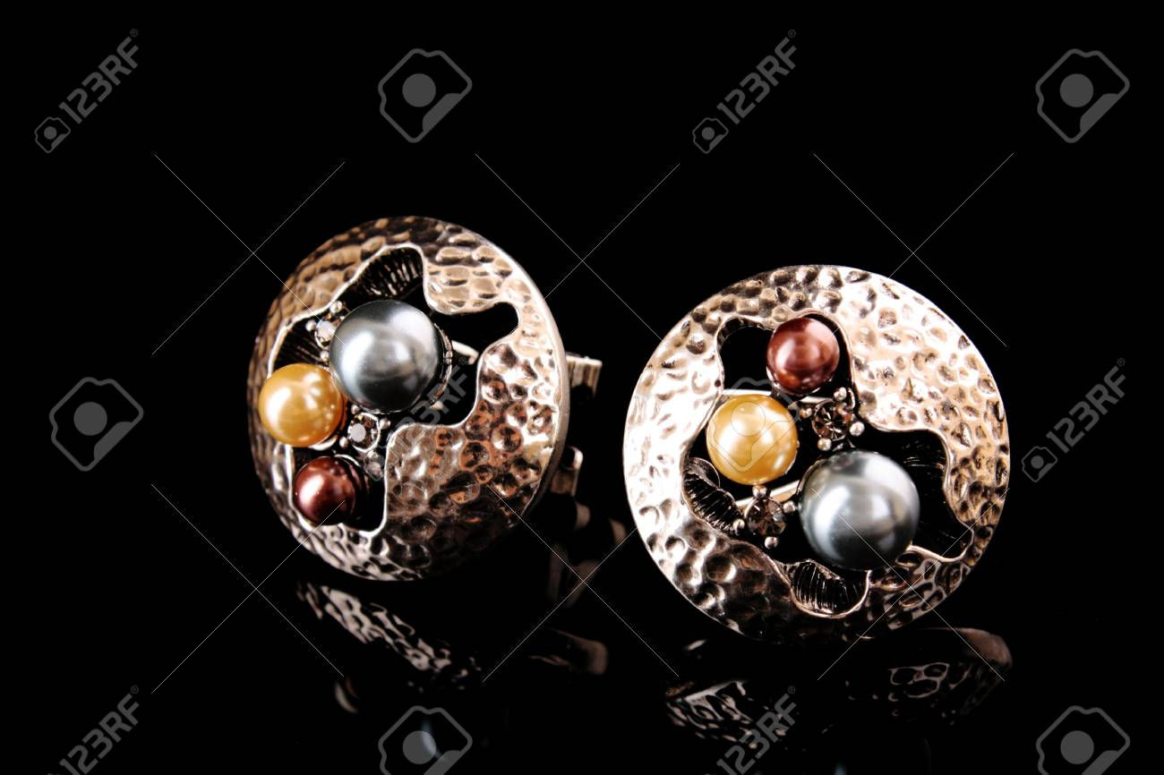 Earrings with pearls isolated on black Stock Photo - 8548347