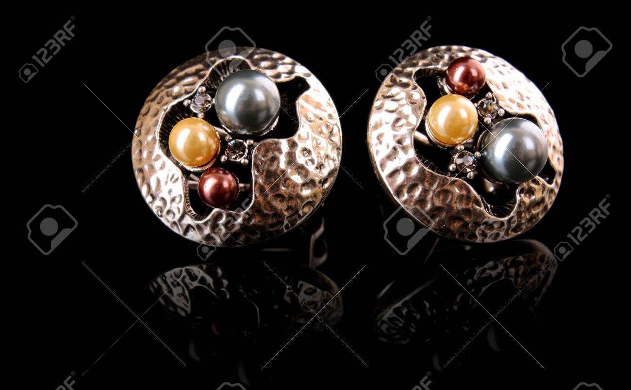 Earrings with pearls isolated on black Stock Photo - 8812575