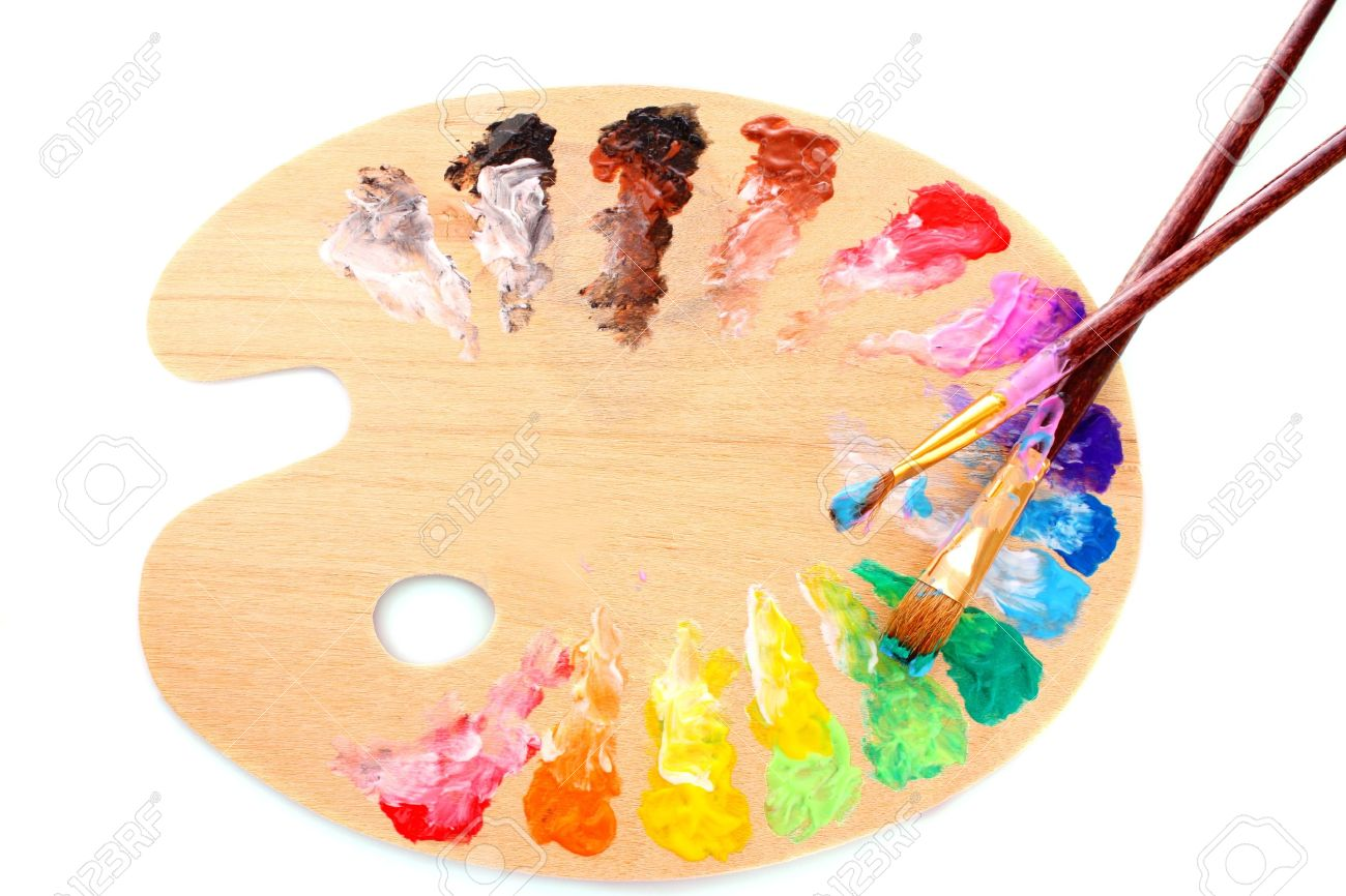 wooden art palette with blobs of paint and a brush on white background Stock Photo - 8983099