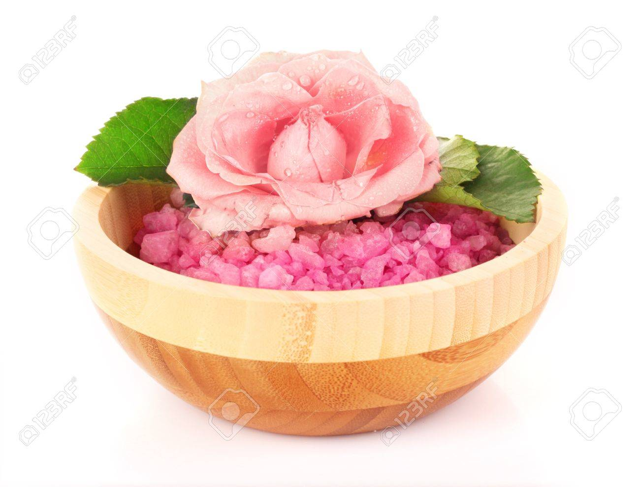 bowl of pink bath salt with flower on white Stock Photo - 9211093