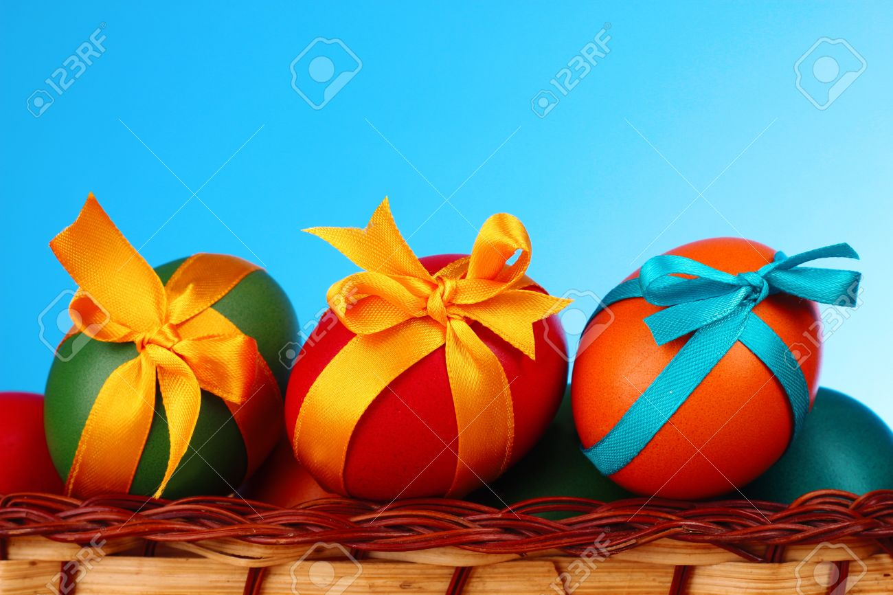 Easter eggs with  bows isolated on white Stock Photo - 9211194