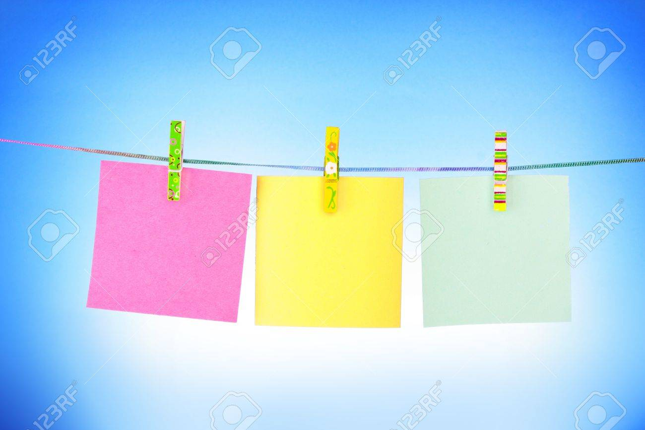 Blank paper sheets on a clothes line on a blue background Stock Photo - 9251106