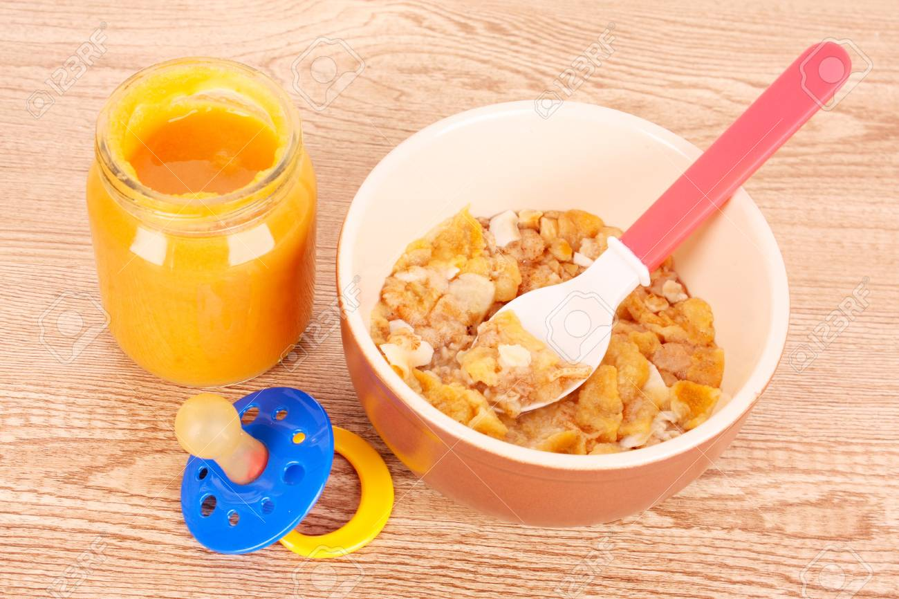 food for children and spoon on brown background Stock Photo - 9371091