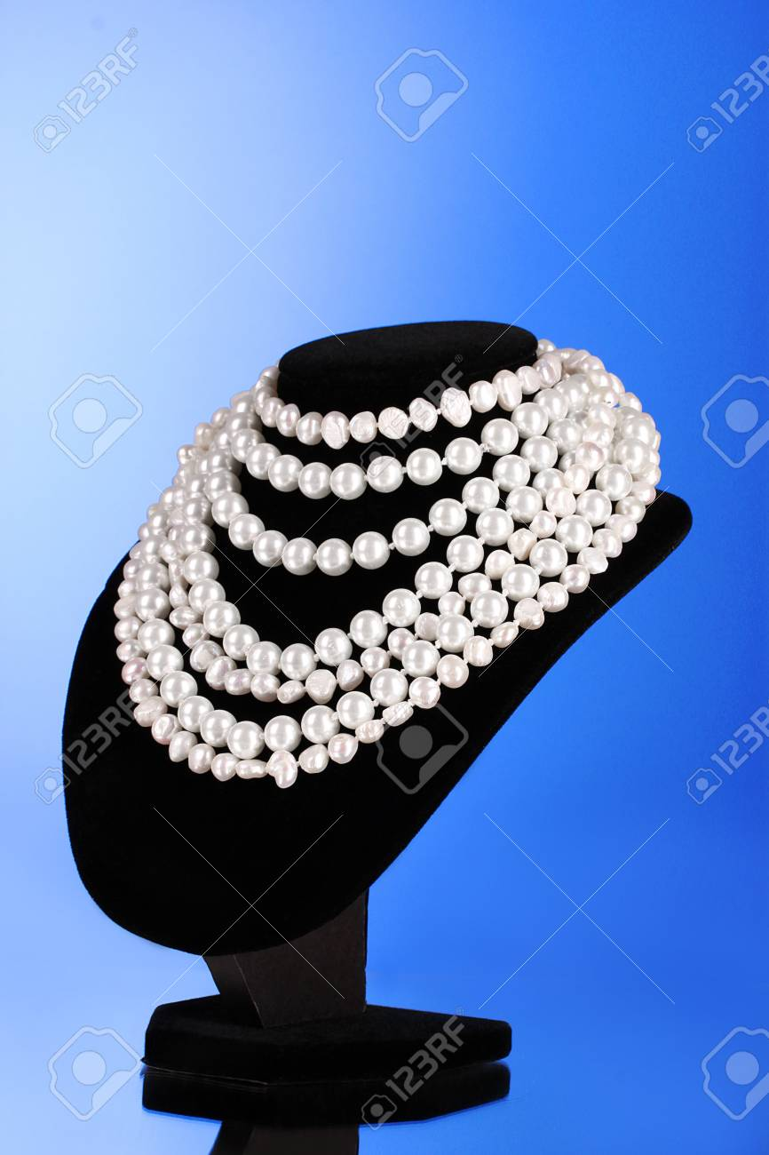 pearl necklace on a mannequin on a blue background Stock Photo - 9999305