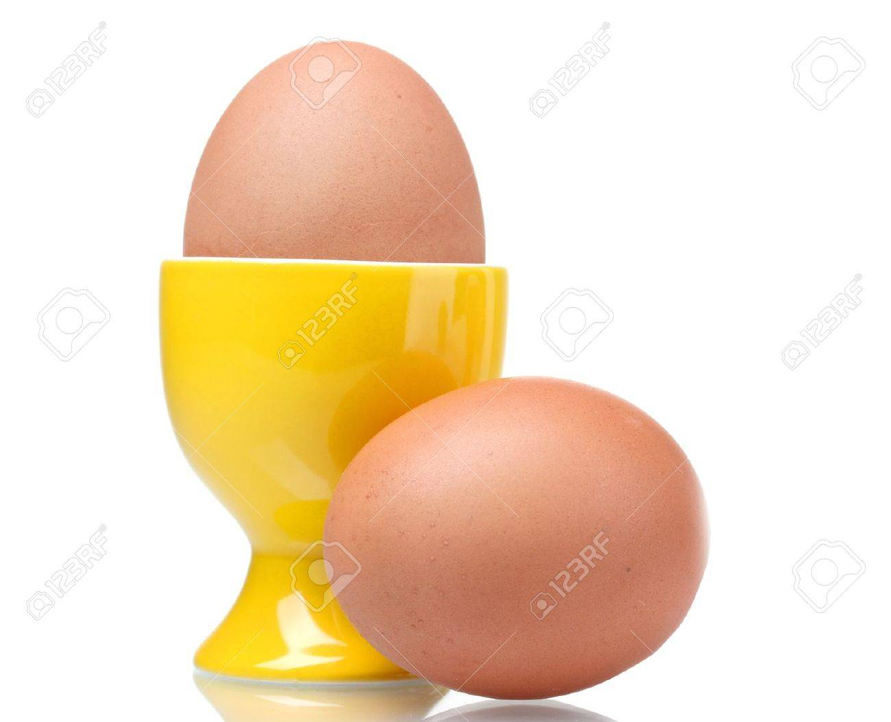 boiled eggs in yellow stand isolated on white Stock Photo - 10327262