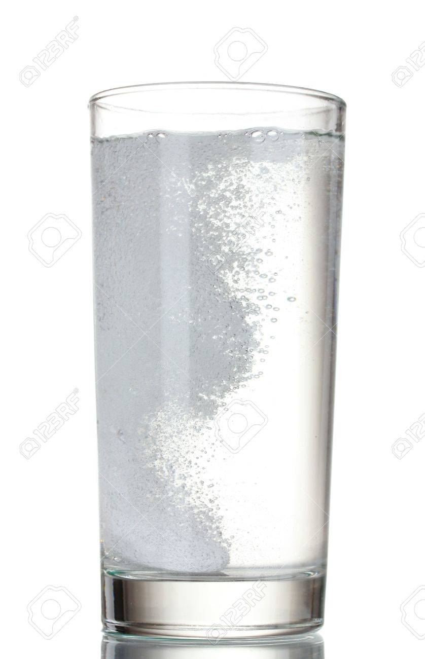 Glass with efervescent tablet in water isolated on white Stock Photo - 10534247