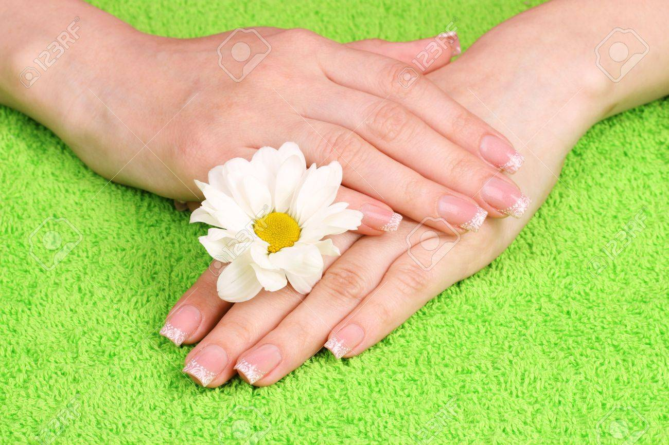 Beautiful hand with perfect nail french manicure  on towel background Stock Photo - 10560060