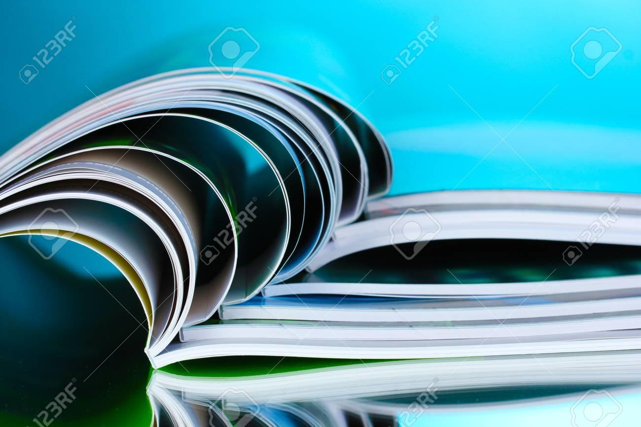 magazine on blue background Stock Photo - 10589477