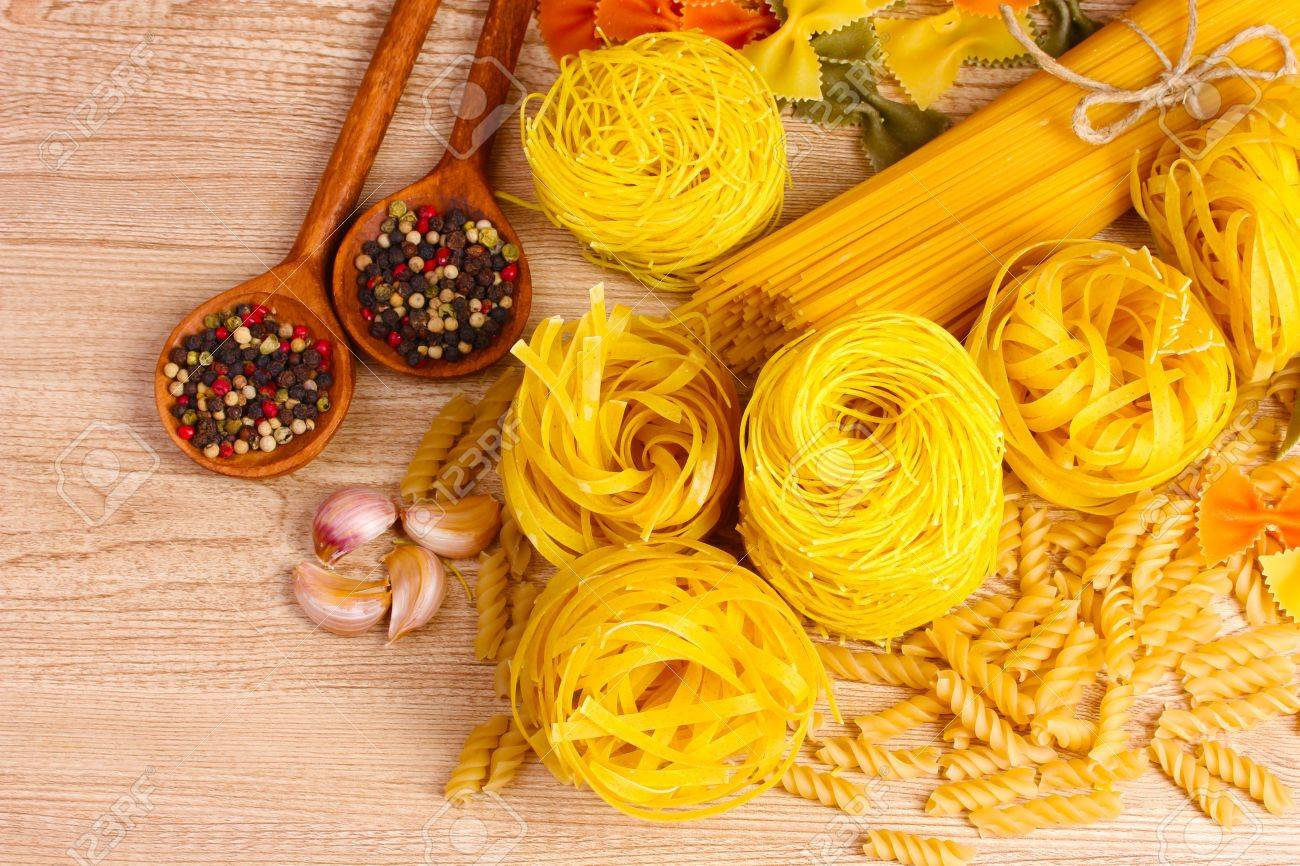 tasty vermicelli, spaghetti and spices on wooden background Stock Photo - 10589470
