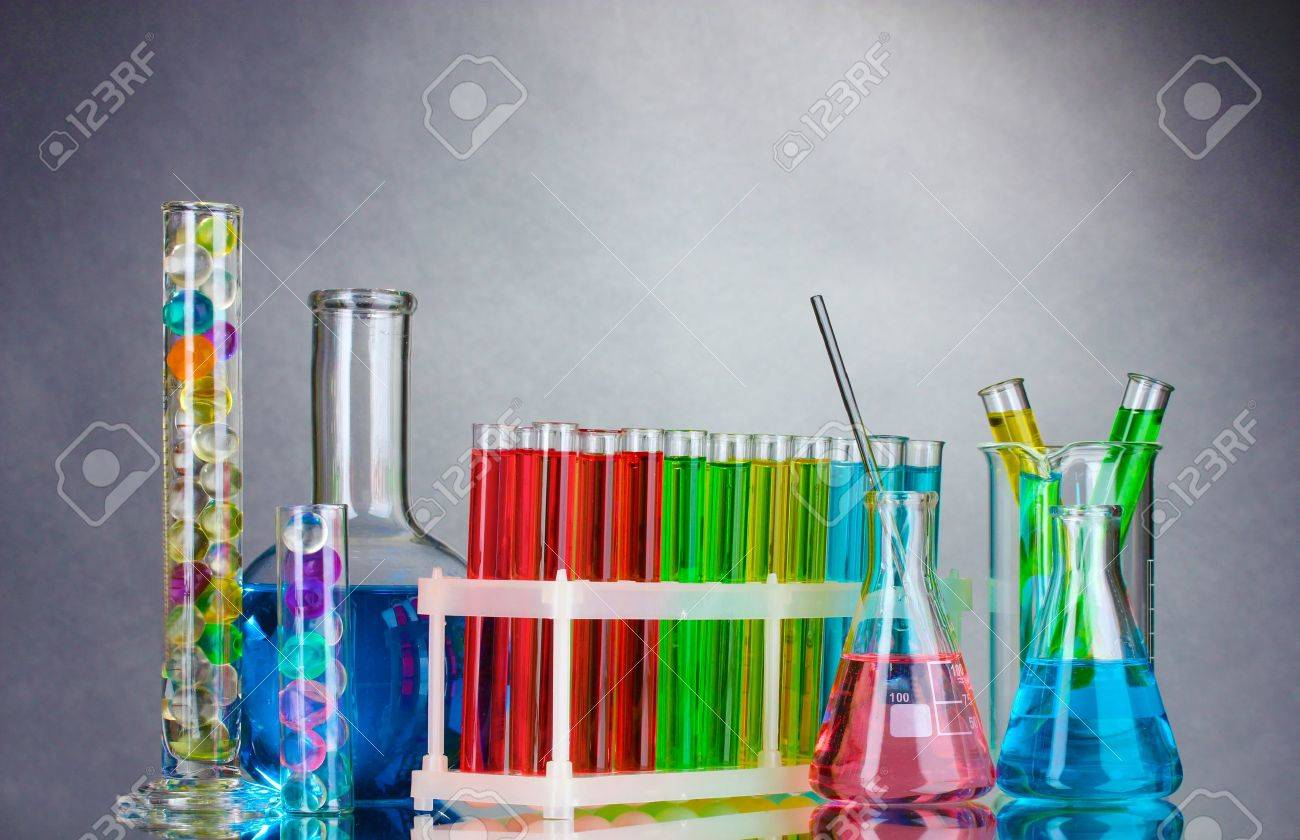 Test-tubes with liquid on gray background Stock Photo - 10589478