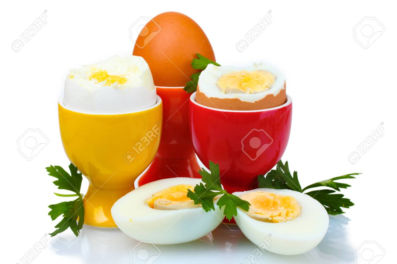 Boiled eggs in bright stands and parsley isolated on white Stock Photo - 10670676