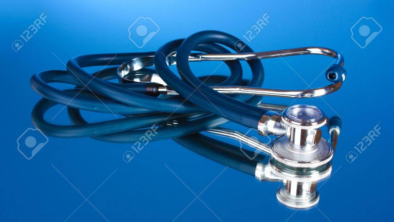 Medical stethoscope on blue background Stock Photo - 10759639
