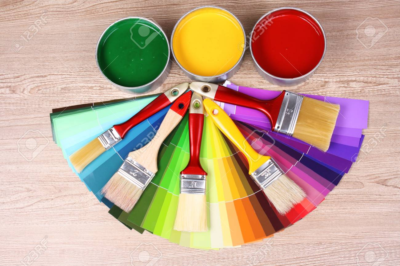 open tin cans with paint and palette on wooden background Stock Photo - 10774383