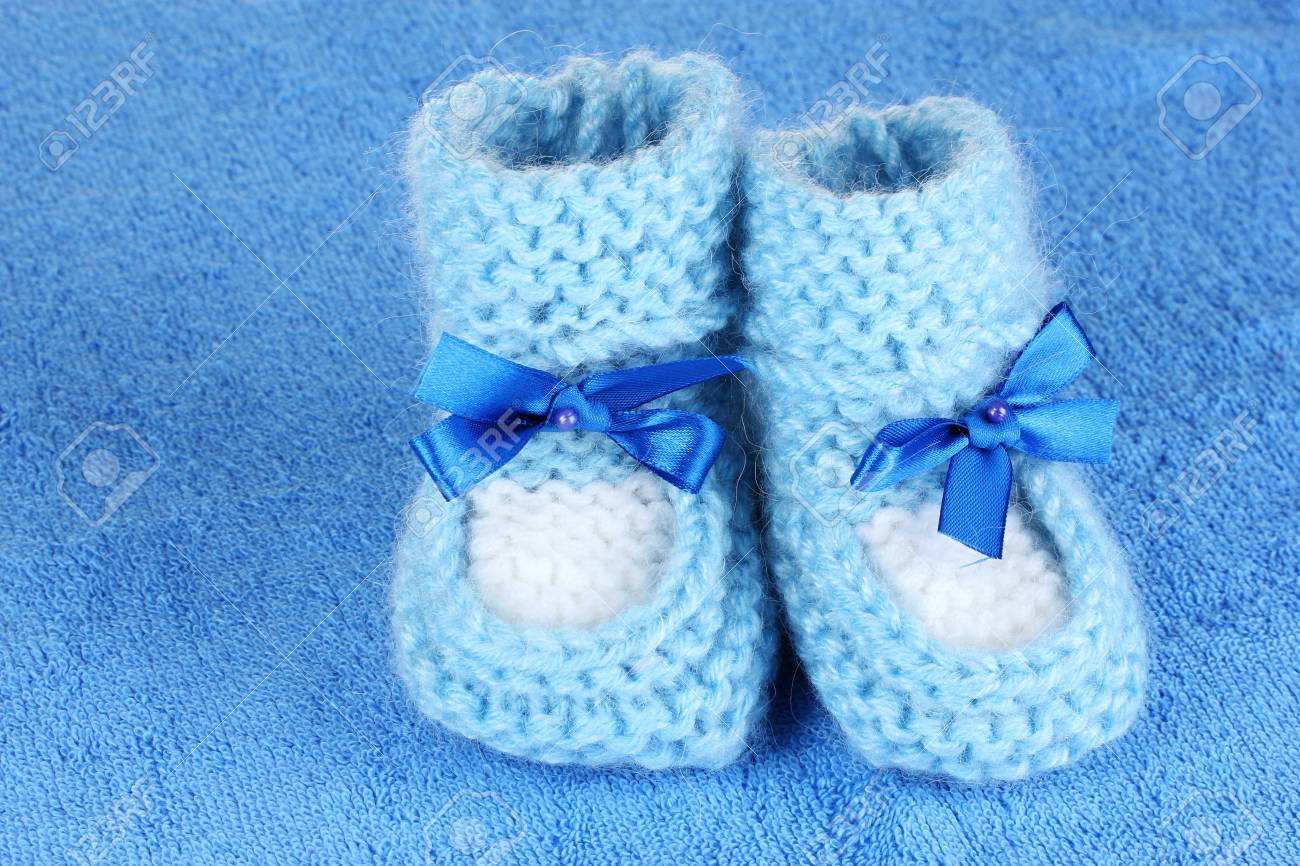 78fd93435301 Blue baby booties on blue background Stock Photo - 10899938