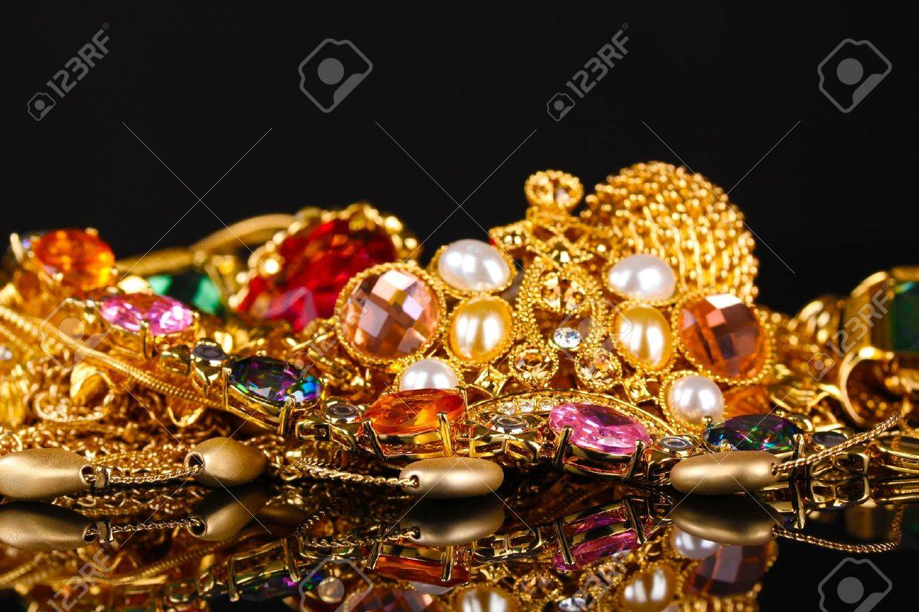 Various gold jewellery on black background Stock Photo - 11037427