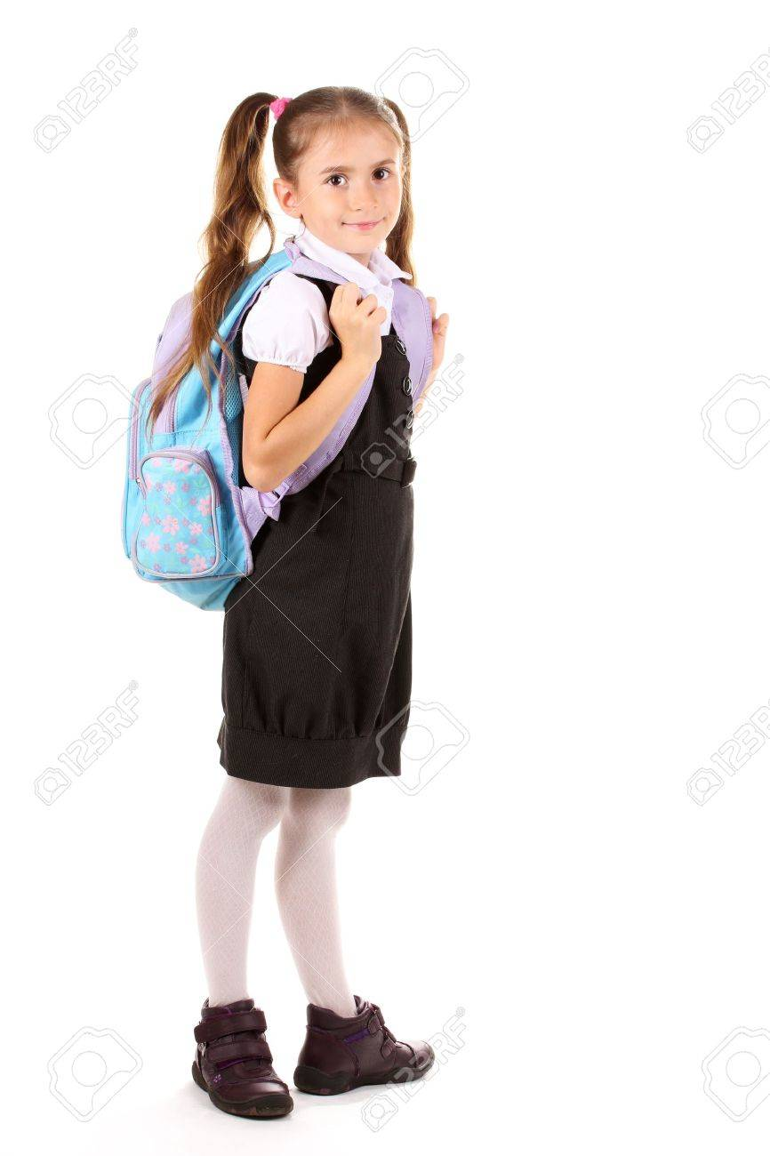 Portrait of beautiful little girl in school uniform with backpack. Isolated on white Stock Photo - 11035141
