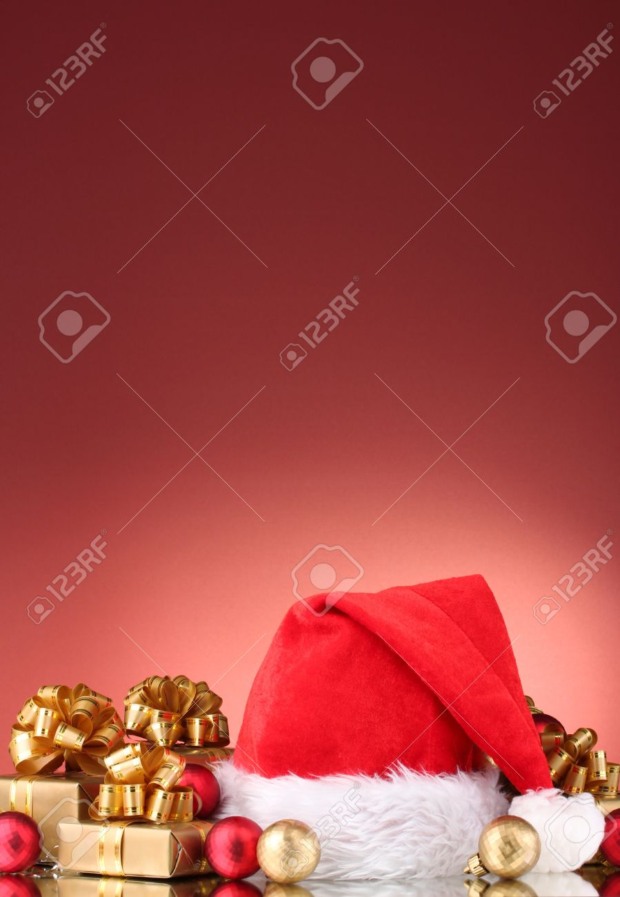 Beautiful Christmas hat, gifts and Christmas balls on red  background Stock Photo - 11123207