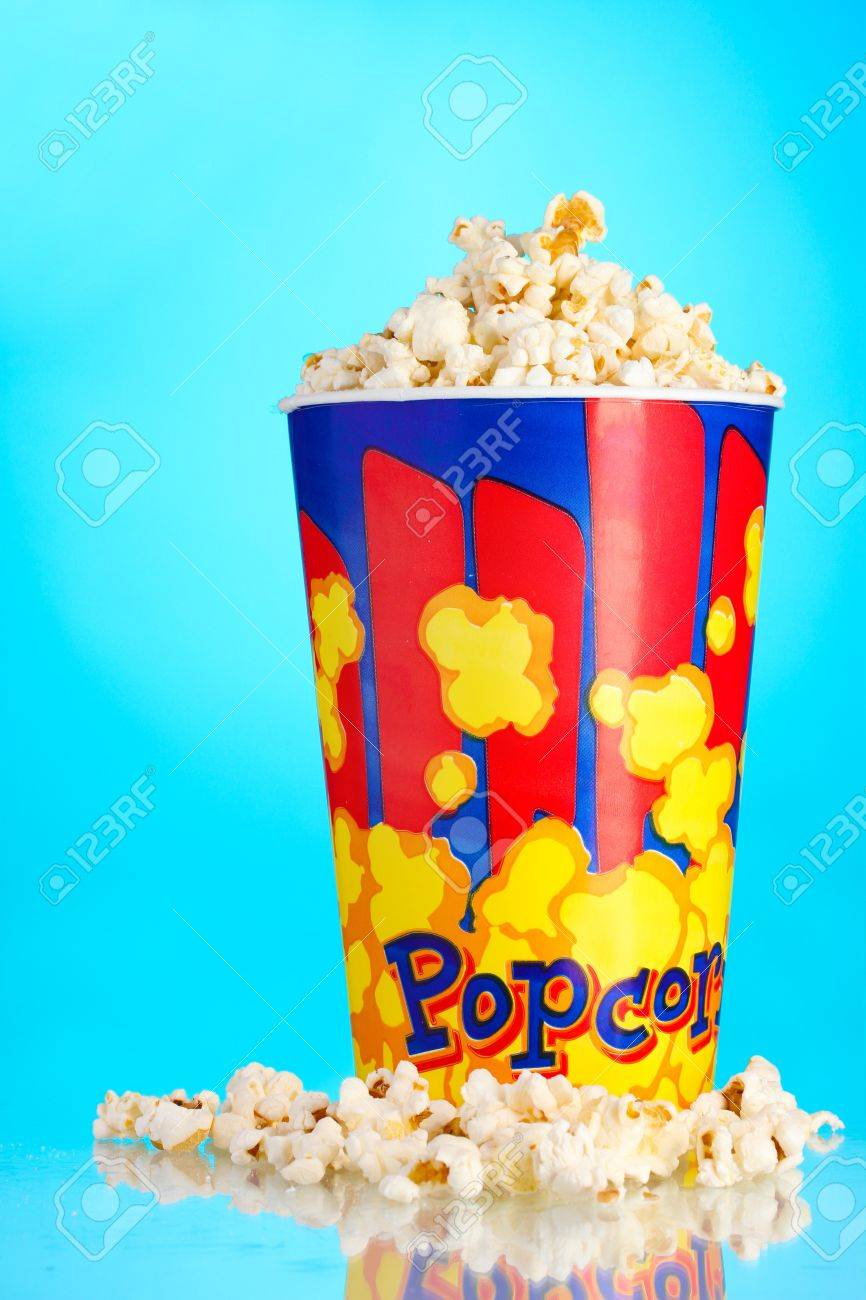 Full Bucket Of Popcorn On Blue Stock Photo Picture And Royalty Free Image Image 11338023