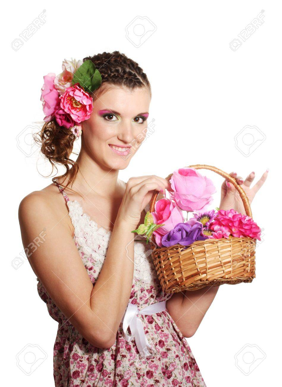 Beautiful girl with flowers in her hair and with a basket of flowers isolated on white Stock Photo - 11497079