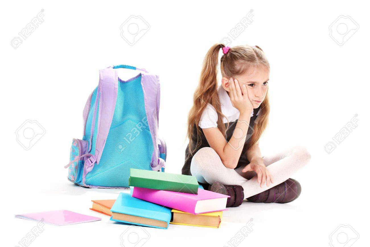 beautiful little girl, books and a backpack isolated on white Stock Photo - 12329822